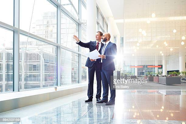 business men discussing plans in modern office - coworker stock pictures, royalty-free photos & images