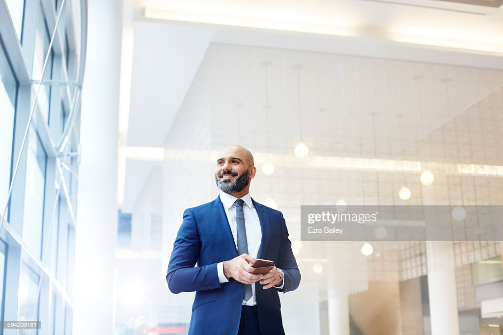 Portrait of a modern businessman in a smart office : Stock Photo
