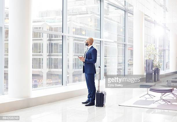 Businessman looking out a window for inspiration.