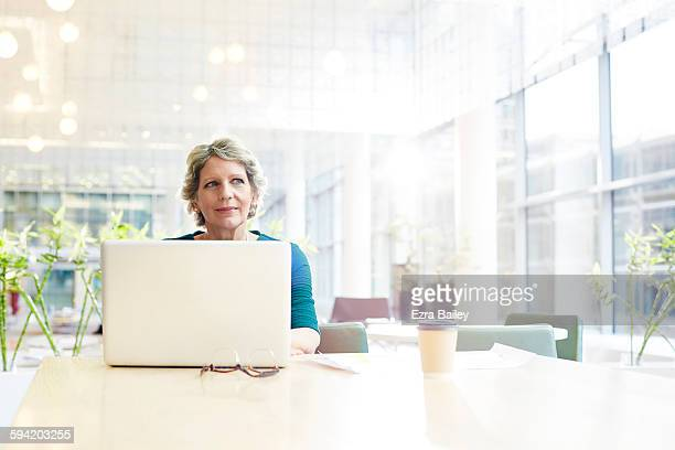 businesswoman working in a modern office. - strategy stock pictures, royalty-free photos & images