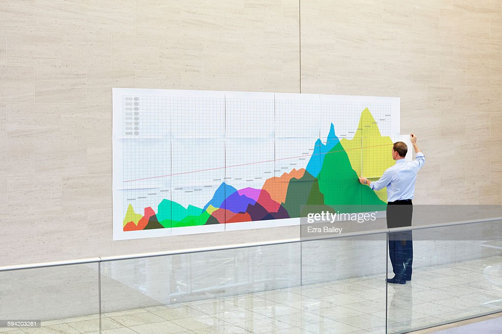 Businessman creates an infographic in an office : Stock-Foto