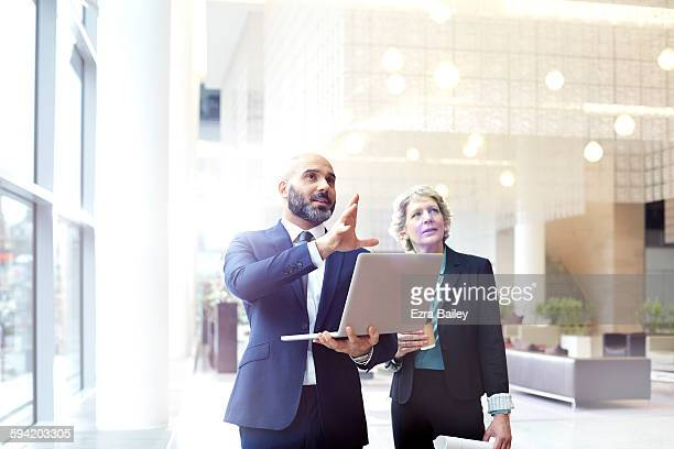 business people discussing plans in modern office. - growth stock pictures, royalty-free photos & images