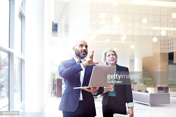 business people discussing plans in modern office. - crescimento - fotografias e filmes do acervo