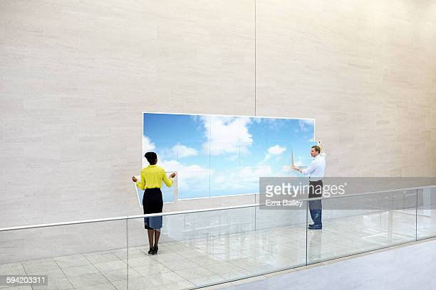 Business people create a cloud in an office