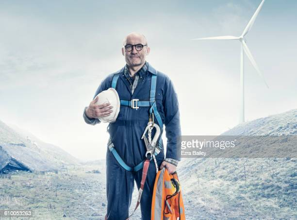 portrait of a wind turbine engineer. - protective workwear stock pictures, royalty-free photos & images