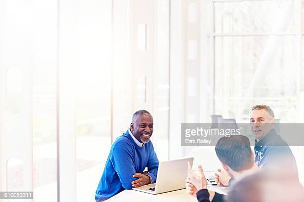 impromptu meeting with work colleagues - business casual stock pictures, royalty-free photos & images