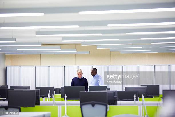 Work colleagues having a catch up in modern office