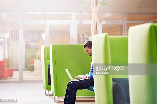 businessman working on his laptop in modern office - place of work stock pictures, royalty-free photos & images