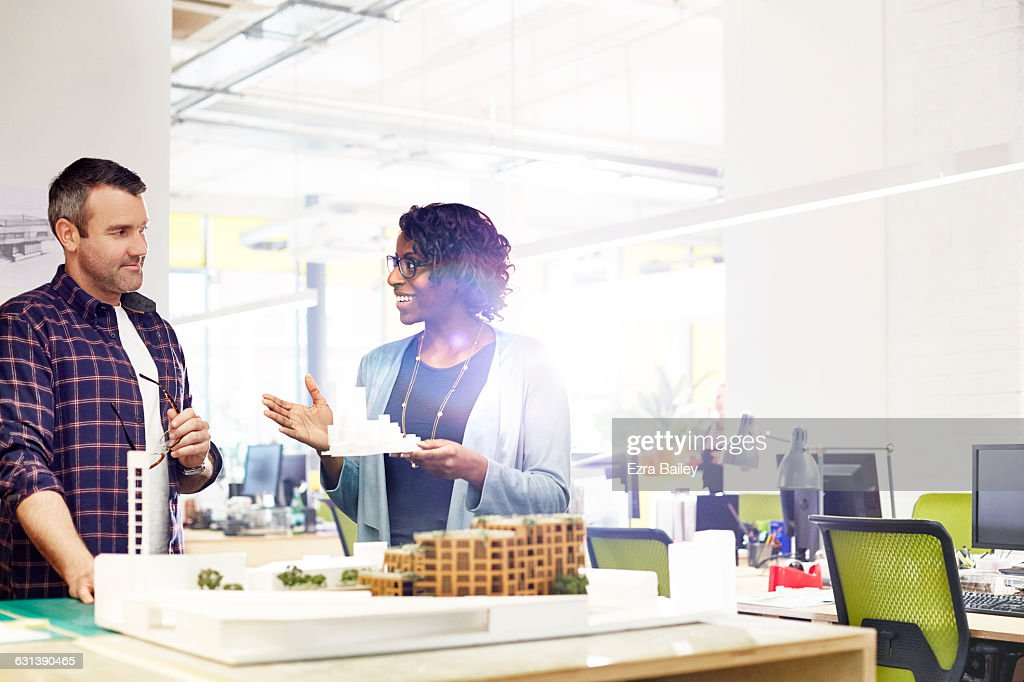 Creative coworkers discuss model ideas : Stock Photo