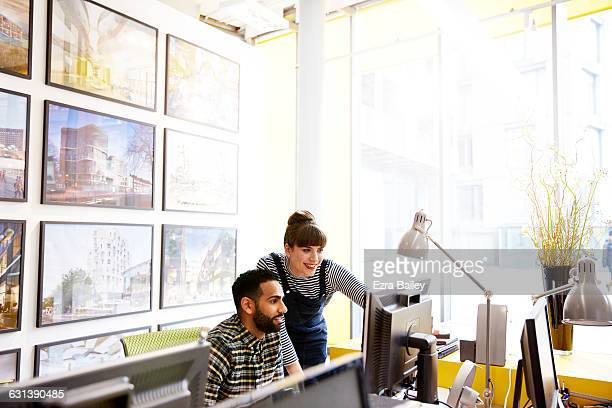 creative colleagues discussing a project. - design professional stock pictures, royalty-free photos & images