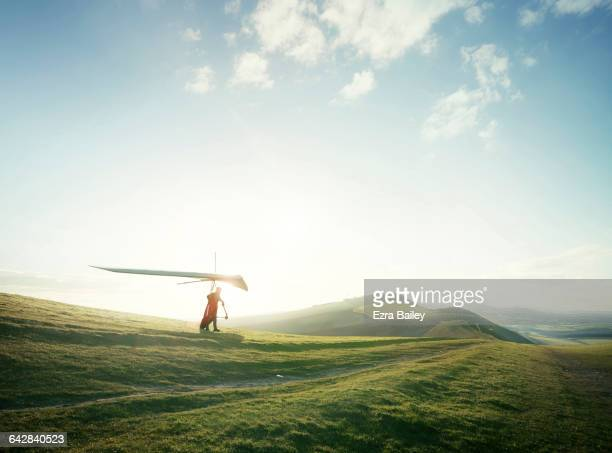 hang glider setting off from hill top. - horizon stock pictures, royalty-free photos & images