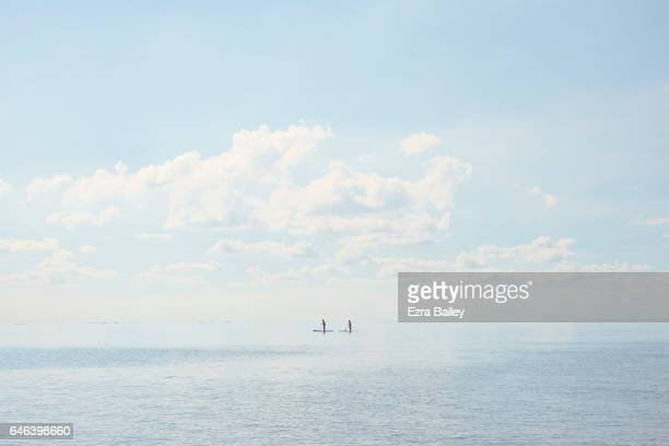 Paddle boarders on a calm sea