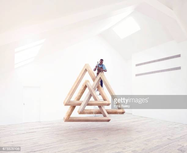 designer creating an impossible triangle sculpture - sculptor stock pictures, royalty-free photos & images