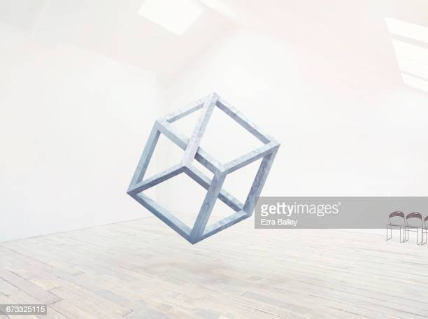 Floating impossible cube in clean white space.