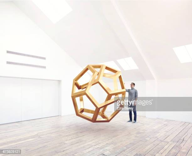 designer being inspired by an impossible shape. - scultura foto e immagini stock