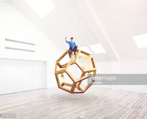 School kid taking a selfie on an impossible shape.