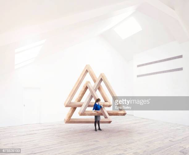 Girl being inspired by impossible triangles.