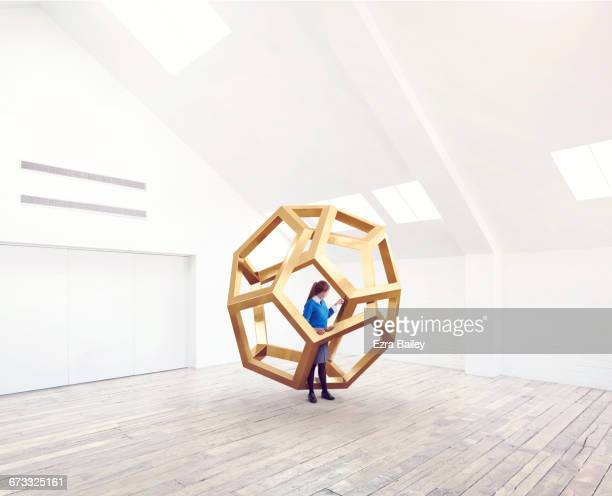 School kid being inspired by an impossible shape.