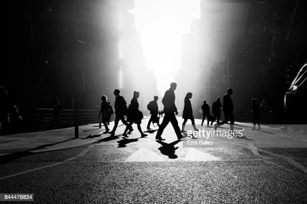business people walking through the city - black and white stock pictures, royalty-free photos & images