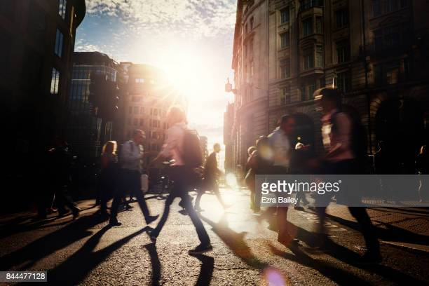 busy business people walking through the city. - twilight stock pictures, royalty-free photos & images
