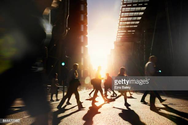 business people walking to work at dawn. - on the move stock pictures, royalty-free photos & images