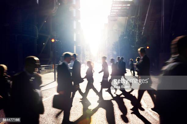 business people walking through the city at dawn. - focus on background stock pictures, royalty-free photos & images