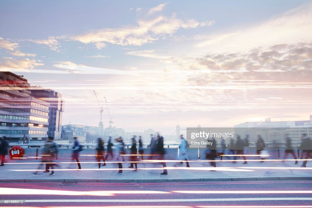 Business people walking through the city at dawn. : Stock Photo