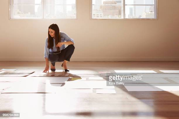 Creative woman in an industrial office reviewing work and thinking of ideas.