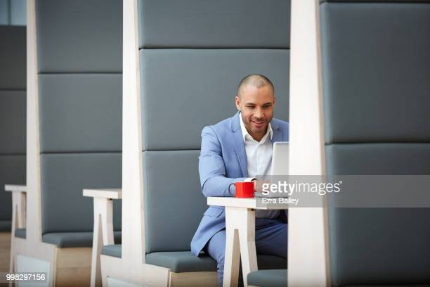 Man working on a laptop in a modern clean office.