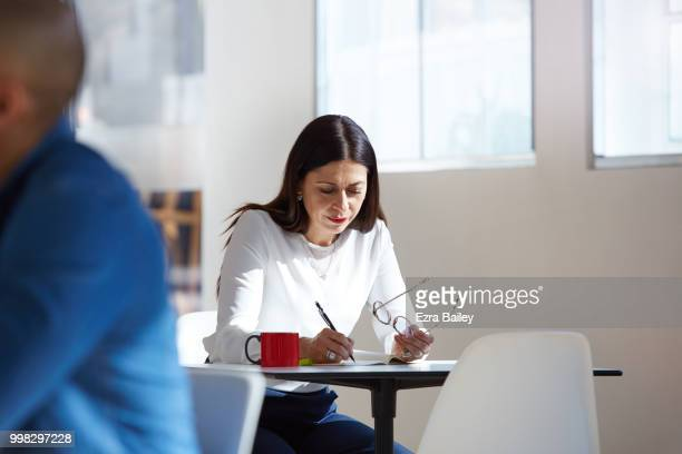 Professional woman working in a clean modern open plan office.
