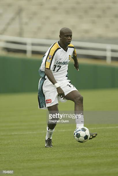 Ezra Henderickson of the Los Angeles Galaxy dribbles the ball during the MLS game against the Chicago Fire on June 8, 2002 at the Rose Bowl in...