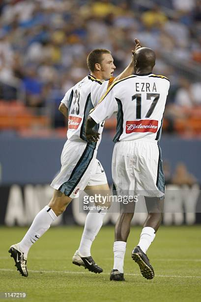 Ezra Hendrickson high-fives Danny Califf of the Los Angeles Galaxy after he headed the ball into the net for the team's first goal against the...
