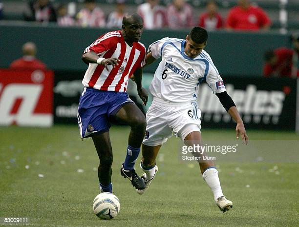 Ezra Hendrickson of Chivas USA fights for the ball against Jose Burciaga of the Kansas City Wizards June 1, 2005 at the Home Depot Center in Carson,...