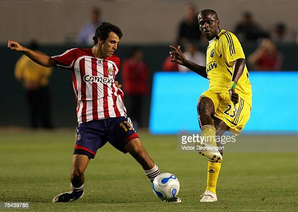 Ezra Hendrickson of the Columbus Crew gets off a pass before Jonathan Bornstein of CD Chivas USA gets a foot on the ball in the second half during...