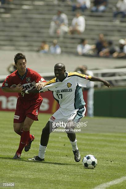 Ezra Hendrickson of the Los Angeles Galaxy and Ante Razov of the Chicago Fire tangle at midfield during the first half of their match on June 8, 2002...
