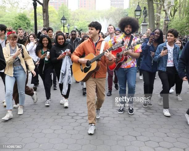 Ezra Koenig Chris Baio and Brian Robert Jones of Vampire Weekend march through Washington Square Park with fans singing Walcott at the finale of...