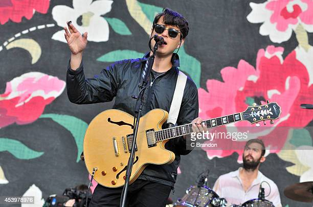 Ezra Koenig of Vampire Weekend performs on stage at the Reading Festival at Richfield Avenue on August 22 2014 in Reading United Kingdom