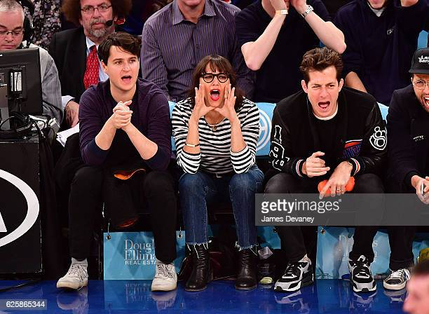 Ezra Koenig Rashida Jones and Mark Ronson attend New York Knicks vs Charlotte Hornets game at Madison Square Garden on November 25 2016 in New York...