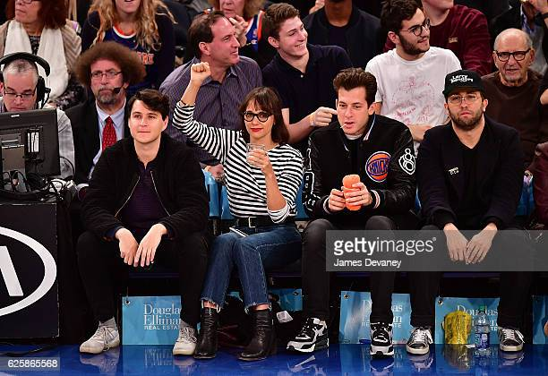 Ezra Koenig Rashida Jones Mark Ronson and guest attend New York Knicks vs Charlotte Hornets game at Madison Square Garden on November 25 2016 in New...