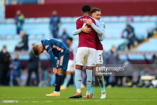 Ezri Konsa and Matty Cash of Aston Villa celebrate after the Premier League match between Aston Villa and Arsenal at Villa Park on February 06, 2021...