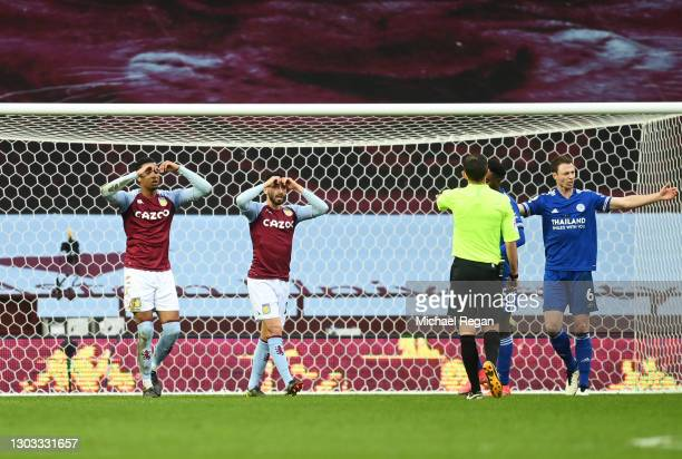 Ezri Konsa and Morgan Sanson of Aston Villa react after missing a chance during the Premier League match between Aston Villa and Leicester City at...