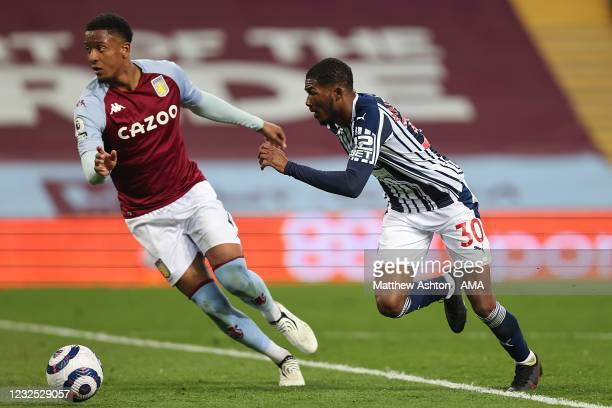 Ezri Konsa of Aston Villa and Ainsley Maitland-Niles of West Bromwich Albion during the Premier League match between Aston Villa and West Bromwich...