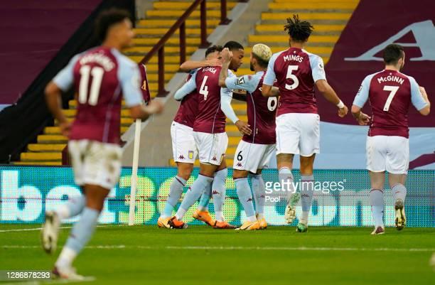 Ezri Konsa of Aston Villa celebrates with teammate Douglas Luiz after scoring his team's first goal during the Premier League match between Aston...