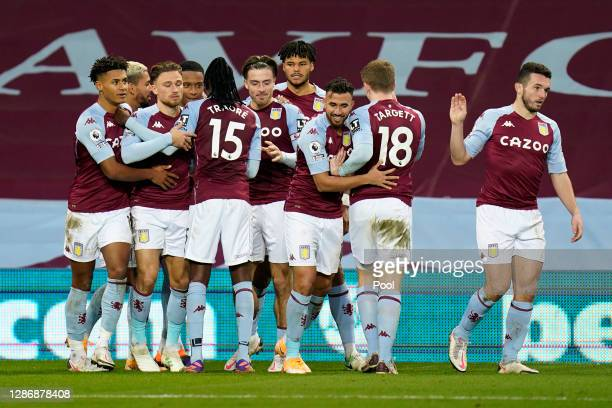 Ezri Konsa of Aston Villa celebrates with teammates after scoring his team's first goal during the Premier League match between Aston Villa and...