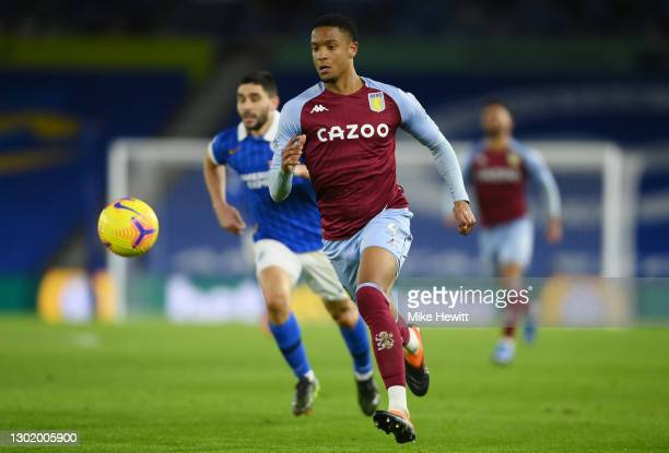 Ezri Konsa of Aston Villa chases the ball during the Premier League match between Brighton & Hove Albion and Aston Villa at American Express...