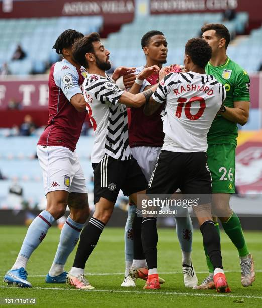 Ezri Konsa of Aston Villa clashes with Marcus Rashford of Manchester United during the Premier League match between Aston Villa and Manchester United...