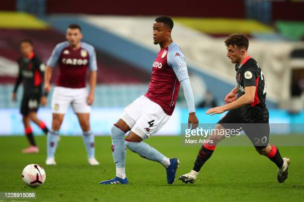 Ezri Konsa of Aston Villa in action with Diogo Jota of Liverpool during the Premier League match between Aston Villa and Liverpool at Villa Park on...