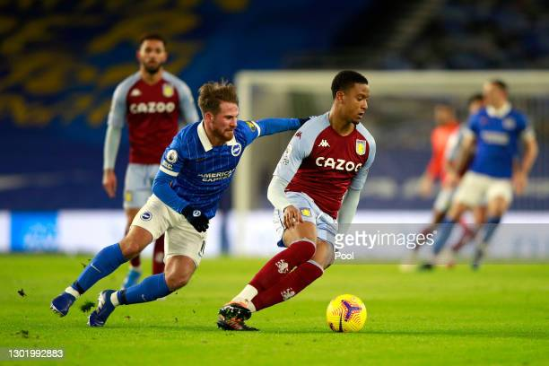 Ezri Konsa of Aston Villa is challenged by Alexis Mac Allister of Brighton & Hove Albion during the Premier League match between Brighton & Hove...