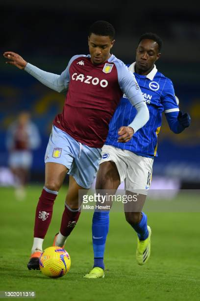 Ezri Konsa of Aston Villa is challenged by Danny Welbeck of Brighton & Hove Albion during the Premier League match between Brighton & Hove Albion and...