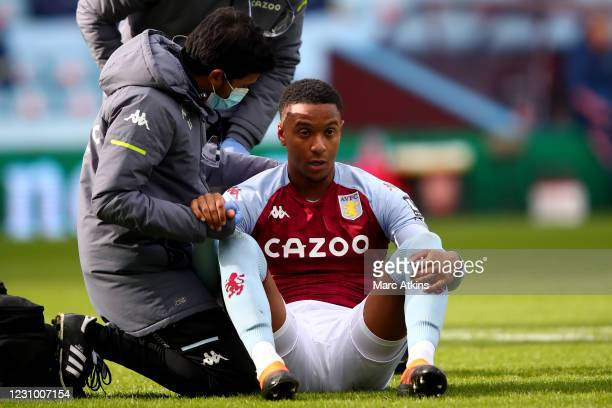 Ezri Konsa of Aston Villa is checked after a clash of heads during the Premier League match between Aston Villa and Arsenal at Villa Park on February...